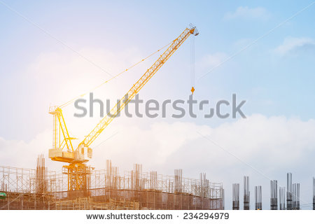 stock-photo-building-site-with-high-rise-block-under-construction-in-an-urban-environment-dominated-by-a-large-234294979